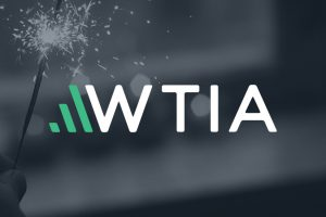 WTIA Logo On Image Of Person Holding A Sparkler. The Power Of We In The Technology Industry