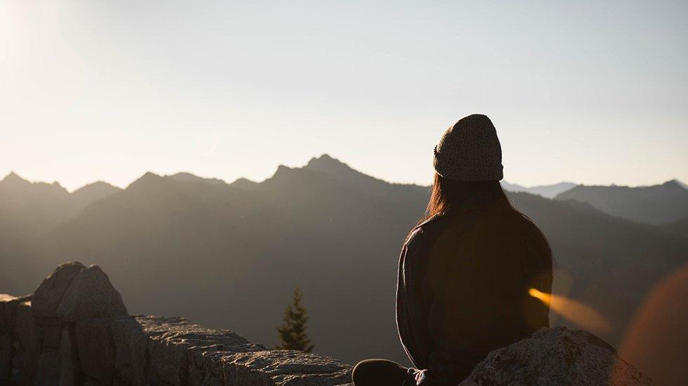 Person Wearing Knit Cap Facing Mountain Range